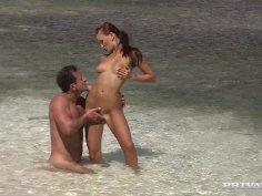 Slutty bitch Claudia Adams fucks on the beach