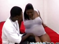 Horny black man enjoys banging a slutty pregnant ebony whore on the bed